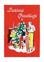 Fifties family Singing Carols around Christmas Tree